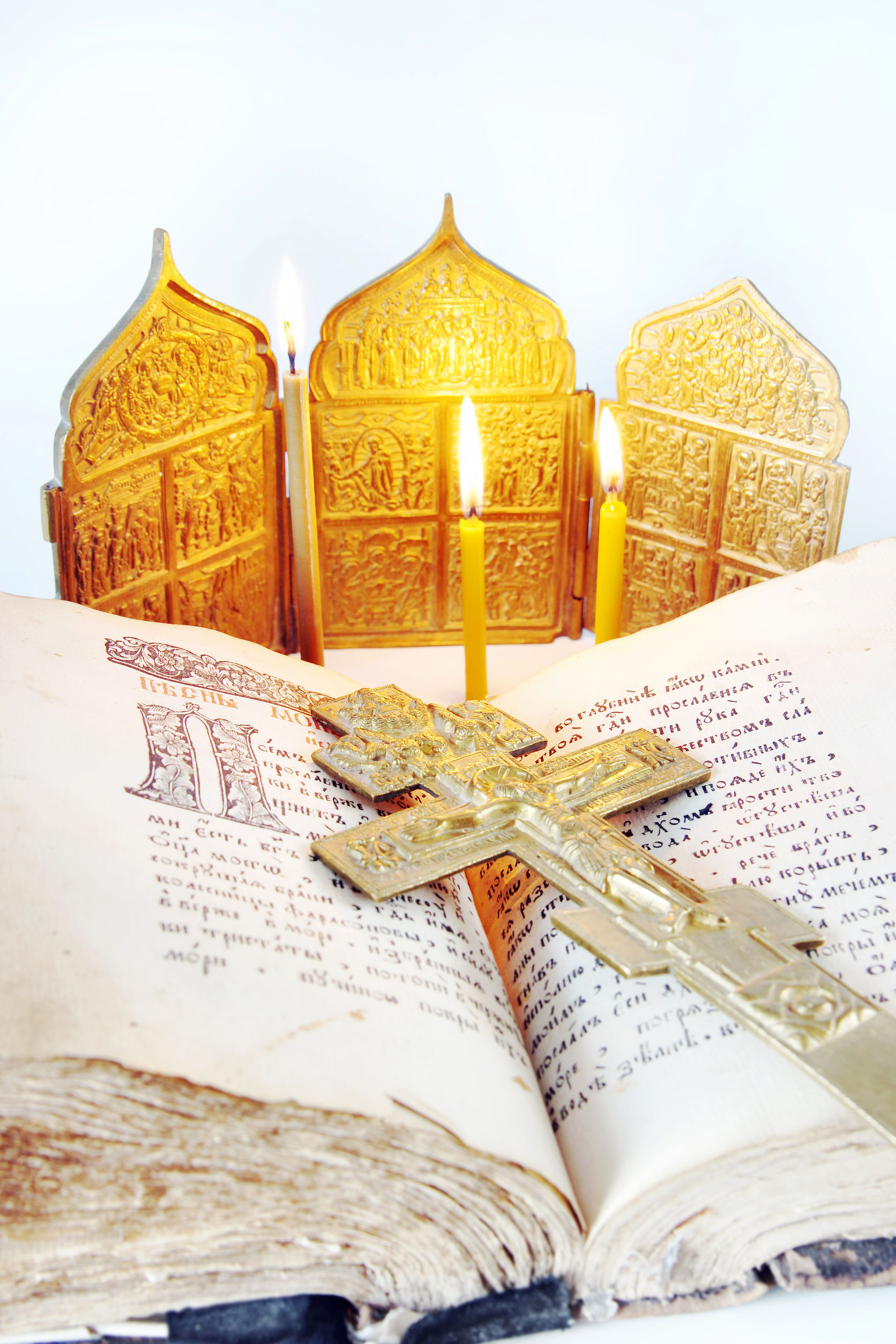 39083002 - orthodox christian still life with an open ancient bible and metal cross on light background
